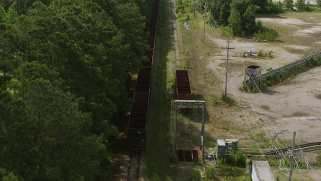 ws aerial pov train tracks passing through forest area with old empty train containers on track / myrtle beach, south carolina, united states - carolina beach stock videos & royalty-free footage