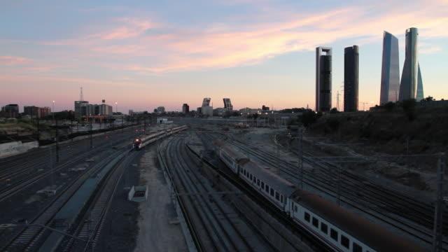 stockvideo's en b-roll-footage met train traffic into chamartì_n station at sunset in madrid - opeenvolgende serie