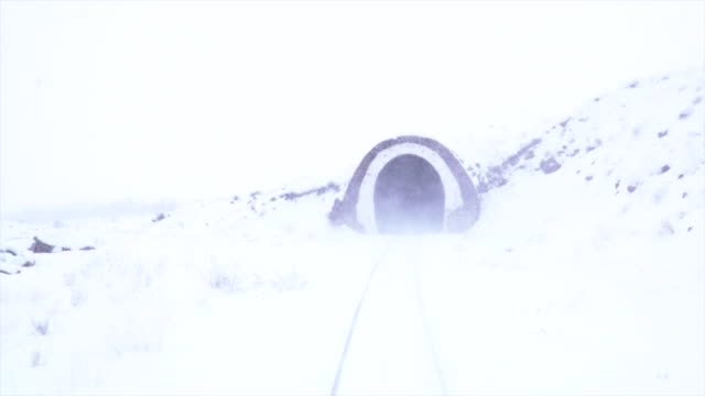 train travel in railway tunnel in winter - cargo container stock videos & royalty-free footage