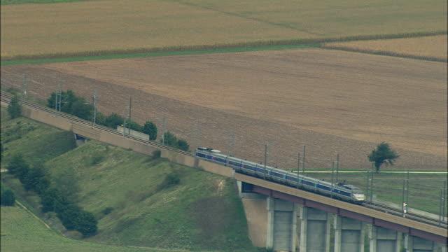 AERIAL WS TGV train traveling across viaduct / Isere, France