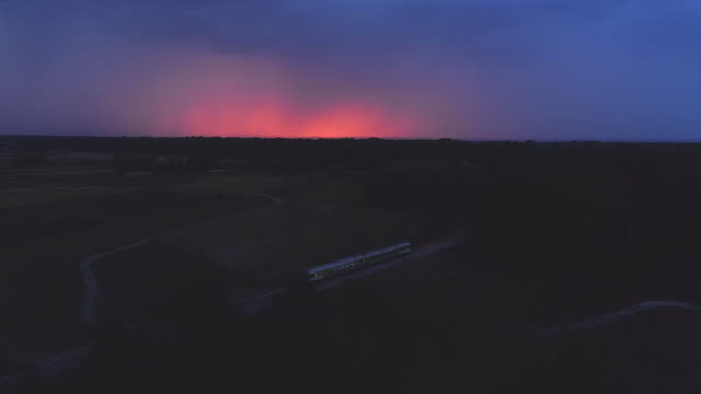 aerial train traveling in thunderstorm - land stock videos and b-roll footage