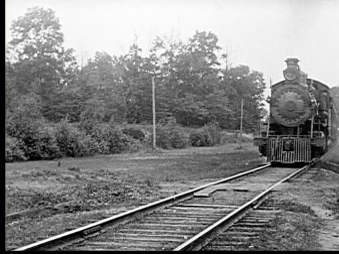 stockvideo's en b-roll-footage met 1915 b/w ws train traveling on track toward camera - 1915