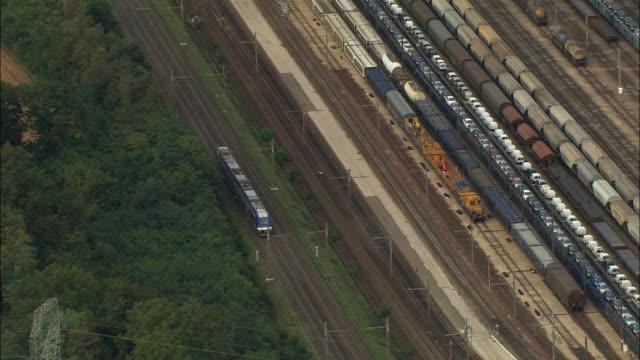 aerial oh ws train traveling on tracks near railway yard / dijon, france - 操車場点の映像素材/bロール