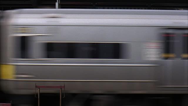 ms train traveling past railroad station platform / new york city, new york, usa - long island railroad stock videos and b-roll footage