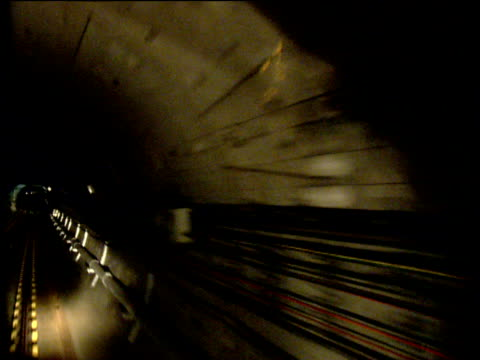 train traveling though underground system - tunnel stock videos & royalty-free footage