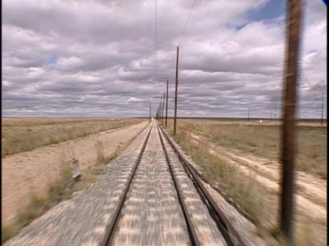 pov, train traveling through flat plains, pueblo, colorado, usa - pueblo colorado stock videos & royalty-free footage