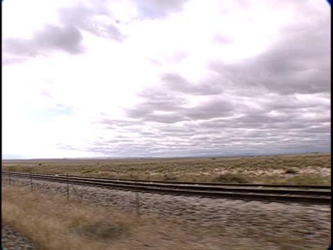 ms, ds, train traveling through flat plains, pueblo, colorado, usa - pueblo colorado stock videos & royalty-free footage