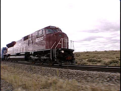 ts, ms, zi, zo, train traveling through flat plains, pueblo, colorado, usa - pueblo colorado stock videos & royalty-free footage