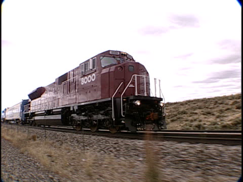ts, ms, train traveling through flat plains, pueblo, colorado, usa, - passenger train stock videos & royalty-free footage