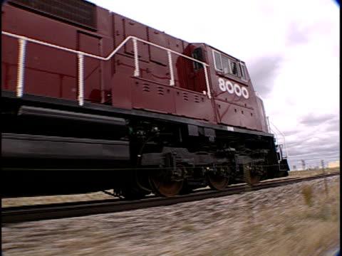 ms, train traveling through flat plains, pueblo, colorado, usa, - pueblo colorado stock videos & royalty-free footage