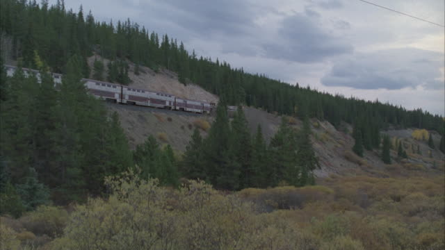 WS, TS, Train traveling through mountain landscape