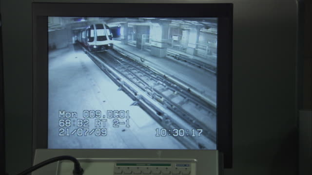 MS Train travelling on tracks from surveillance computer screen throughout / Singapore City, Singapore