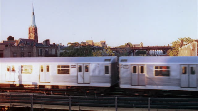 a train travels through a suburb of new york city. - elevated train stock videos & royalty-free footage