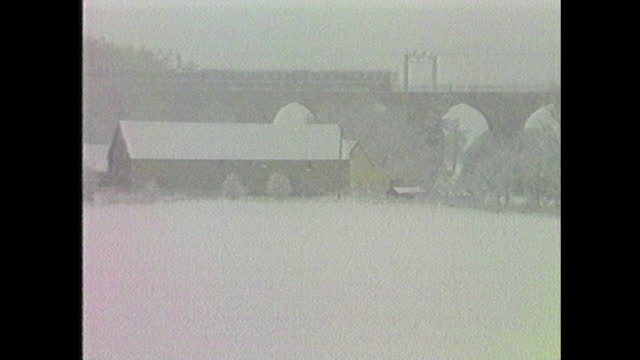 train travels through heavy snowfall in eastern england during blizzards in january 1987. - weather stock videos & royalty-free footage