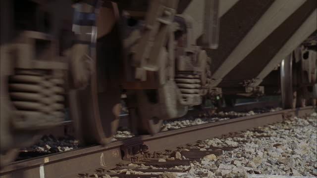pan train wheels rolling on the track - 車輪点の映像素材/bロール