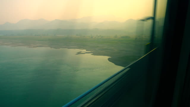 train window view - moving past stock videos & royalty-free footage