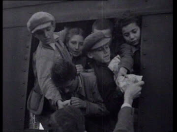 train with 450 jewish children from prague arrives in the netherlands. people on the platform give the children food - judaism stock videos & royalty-free footage
