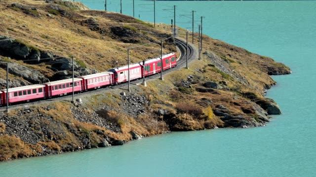 train with lake lago bianco, rhätische bahn, berninapass, grisons, switzerland, european alps - railway track stock videos & royalty-free footage