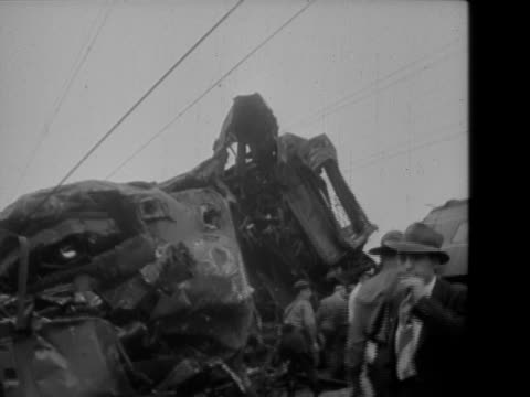 train wreck showing the derailment, investigation team is seen / down track with men investigating the sight / two men stretching a tape measure... - 1956 stock-videos und b-roll-filmmaterial