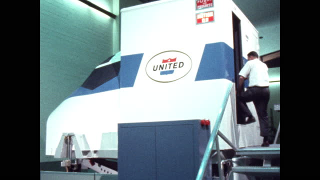 trainee enters united airlines flight simulator - pilot stock videos & royalty-free footage