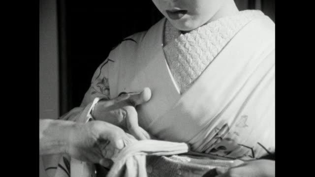 cu trainee geisha having obi sash fitted correctly; 1966 - femininity stock videos & royalty-free footage