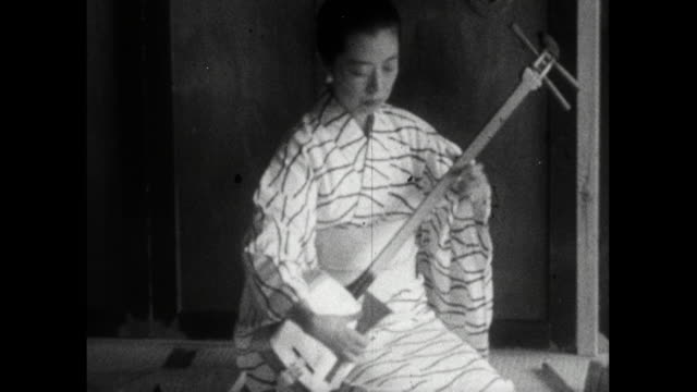 trainee geisha learn how to play shamisen instrumentr; 1959 - femininity stock videos & royalty-free footage