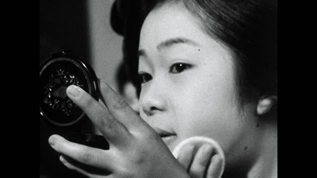 cu trainee geisha (maiko) powdering her face; 1964 - kyoto prefecture stock videos & royalty-free footage