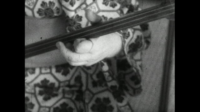 cu of trainee geisha's hands playing shamisen instrument; 1959 - femininity stock videos & royalty-free footage