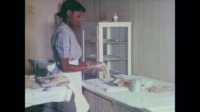 trainee nursing assistant washes medical instruments in tap water before placing in sterilizer - washing up glove stock videos & royalty-free footage