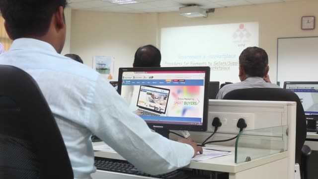 a trainee uses a mouse while sitting in front of a computer screen displaying the government e marketplace website during a class at the national... - haryana stock videos & royalty-free footage
