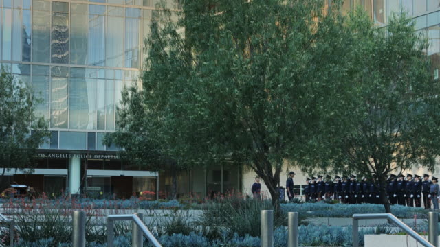 lapd trainees on parade outside downtown hq - los angeles police department stock videos & royalty-free footage