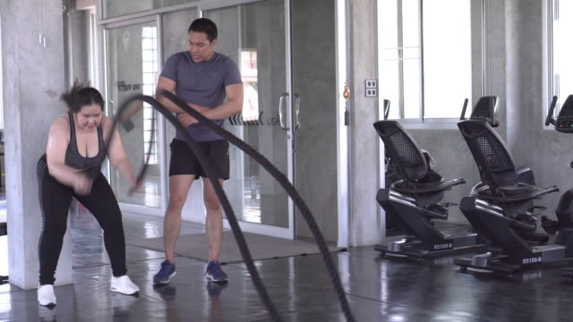 trainer and overweight girl play rope exercise - addition key stock videos & royalty-free footage