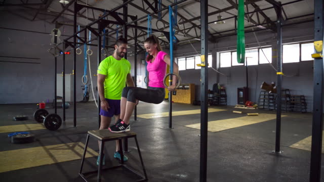ws trainer with class doing workout in gym - gymnastic rings stock videos & royalty-free footage