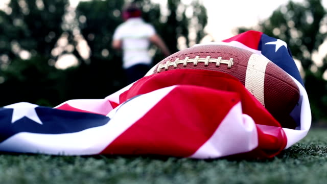 Training American flag and a rugby ball
