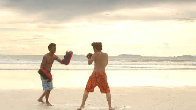 training boxing on the beach - mitten stock videos and b-roll footage