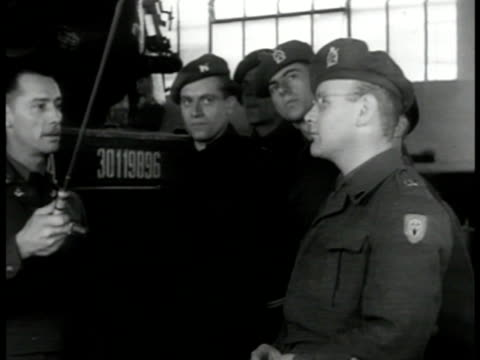 training center w/ european american flags int vs instructors showing army officials tanks students looking at artillery lectures on electrical... - 1951 stock-videos und b-roll-filmmaterial