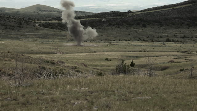 a training explosive goes off in a far field - explosive stock videos & royalty-free footage