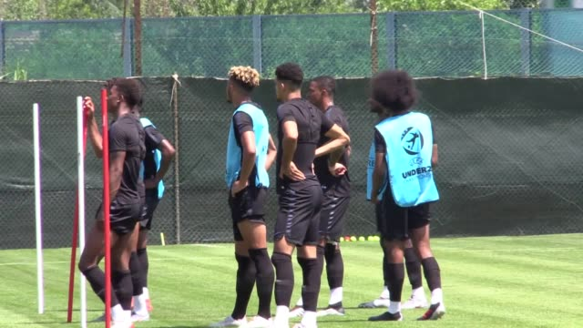 Training footage of the England U21s squad ahead of their first match of Euros against France includes shots of manager Aidy Boothroyd James Maddison...