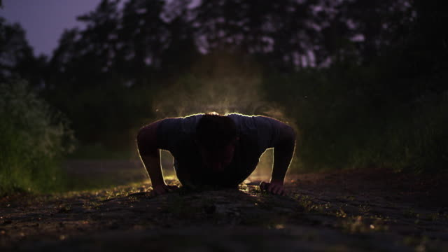 training in extreme conditions. night outdoor pushups - masculinity stock videos & royalty-free footage