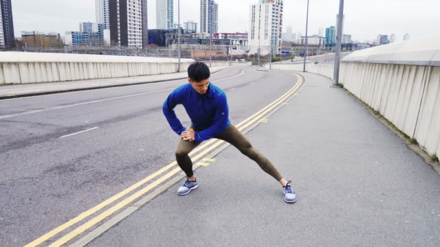 training on the rainy day in the streets of london, uk. - london marathon stock videos & royalty-free footage