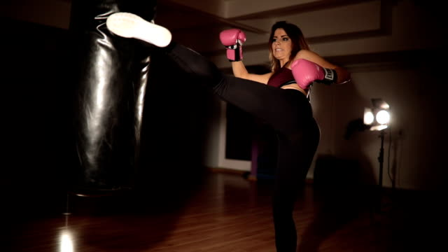 training with a punching bag at the gym - self defence stock videos & royalty-free footage