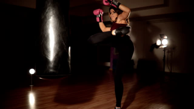 training with a punching bag at the gym - self defense stock videos and b-roll footage