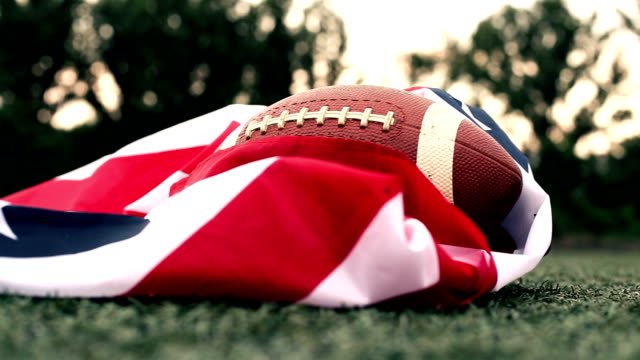 Training with an American flag and a rugby ball
