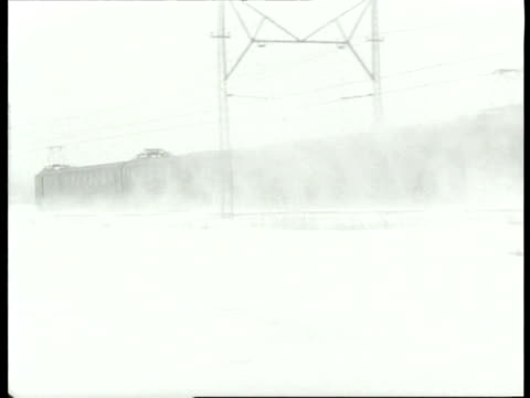 stockvideo's en b-roll-footage met trains and trams riding through snow during severe winter / haarlem noordholland netherlands - noord holland