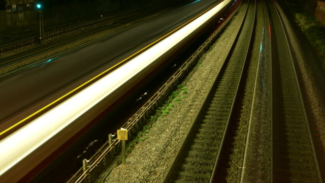 trains and tube trains travel rapidly over the railway lines of a busy north london tube and rail network - railway track stock videos & royalty-free footage