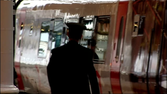 trains at newcastle station on north east line; england: tyne and wear: newcastle: ext close shot of train with light reflected on it passenger along... - www stock-videos und b-roll-filmmaterial