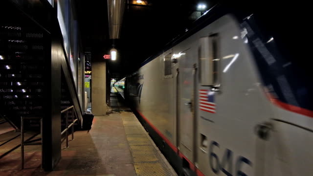 trains at penn station video and timelapse of people in line for trains people in the waiting area ticketing booth in new york new york united sates... - new york city penn station stock videos & royalty-free footage