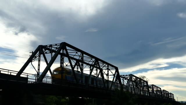 trains crossing a railway viaduct - tramway stock videos & royalty-free footage