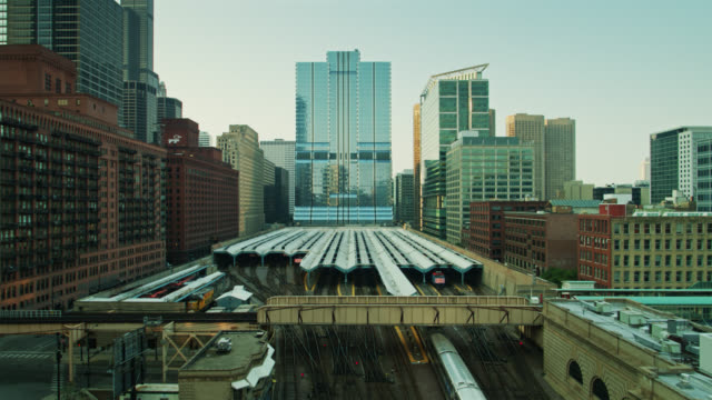 trains crossing paths at ogilvie transportation center in chicago - drone shot - chicago 'l' stock videos & royalty-free footage