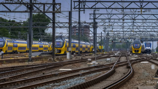 trains leaving from and arriving at amsterdam centraal station - railway track stock videos & royalty-free footage